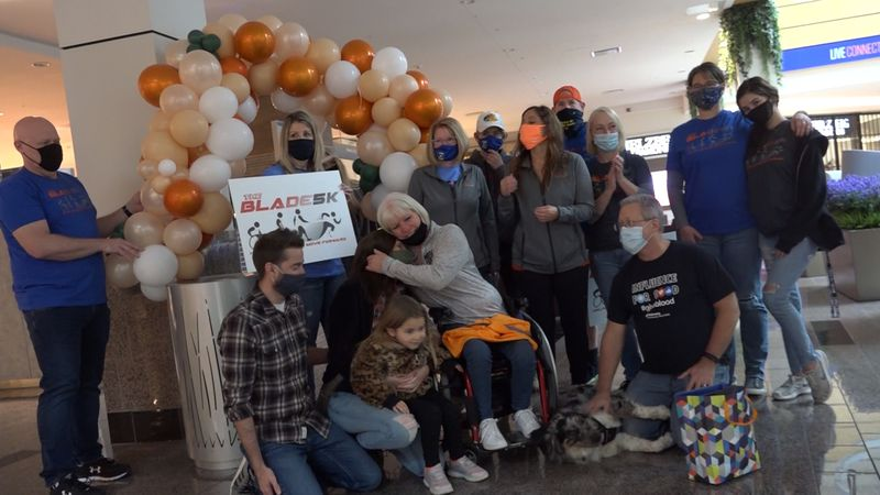 Holding signs and a balloon arch, Connie Belt was left with few words after hearing the news...