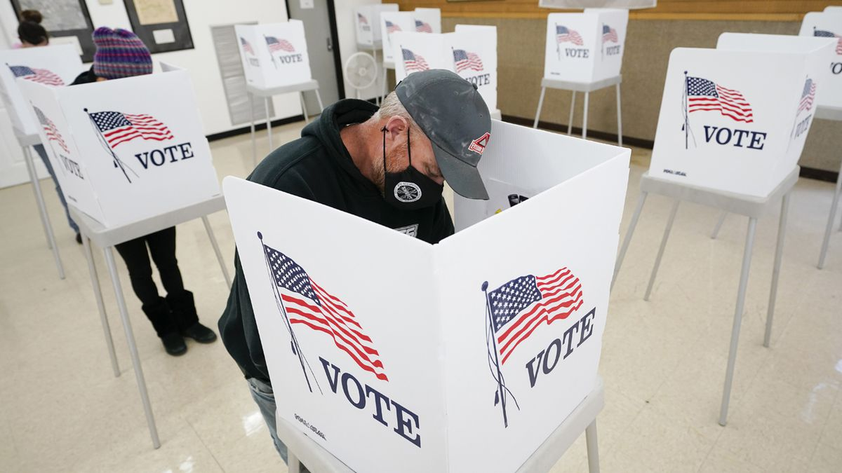 Chris Helps, of Earlham, Iowa, fills out his ballot during early voting, Tuesday, Oct. 20,...