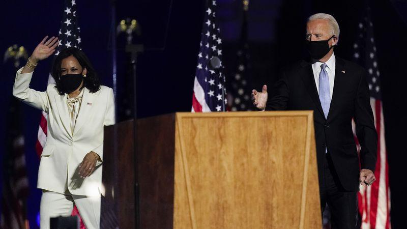 President-elect Joe Biden and Vice President-elect Kamala Harris wave to the crowd Saturday,...