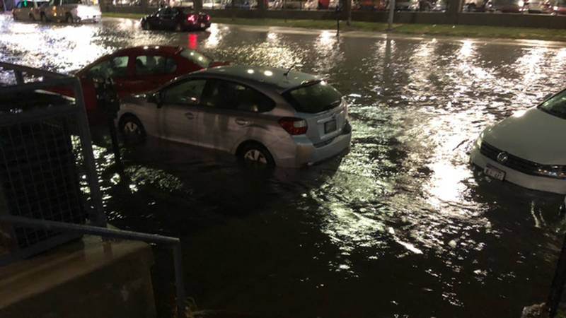 Flash flooding pushed cars around in downtown Omaha on Saturday night, Aug. 7, 2021.