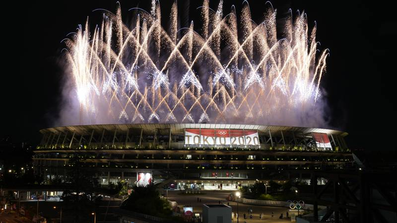 Fireworks illuminate over the National Stadium during the opening ceremony of the 2020 Summer...