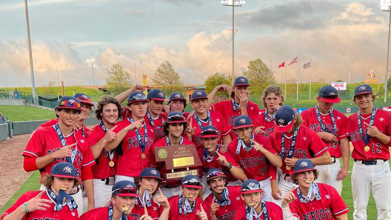 The Millard South baseball team poses with the Class A championship trophy at Haymarket Park in...
