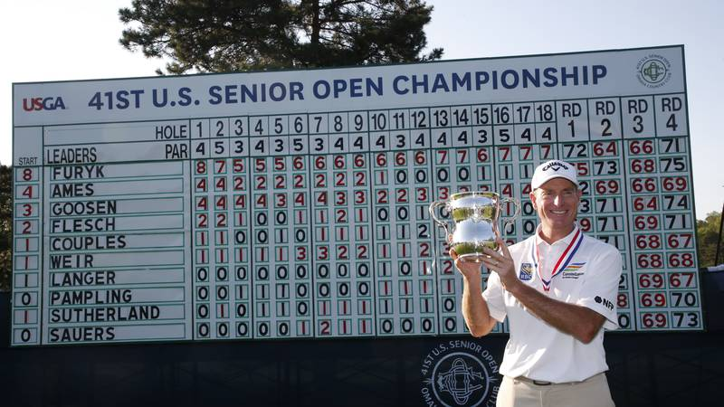 Jim Furyk poses with trophy after winning the 2021 U.S. Senior Open at Omaha Country Club in...