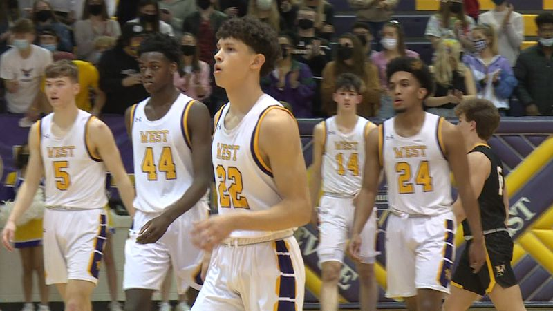 Bellevue West players head to the bench after a Josiah Dotzler three pointer in the T-bird's...