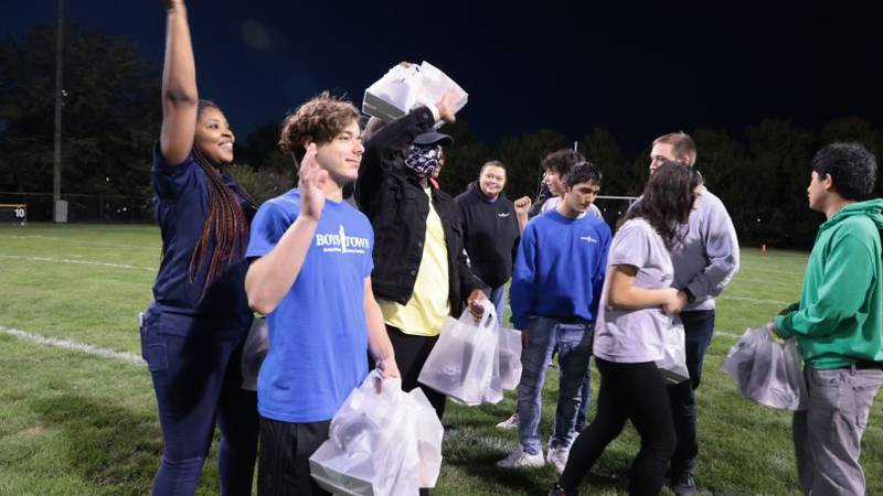 Students visiting from Boys Town New Orleans honored at halftime of Boys Town Nebraska Cowboys...