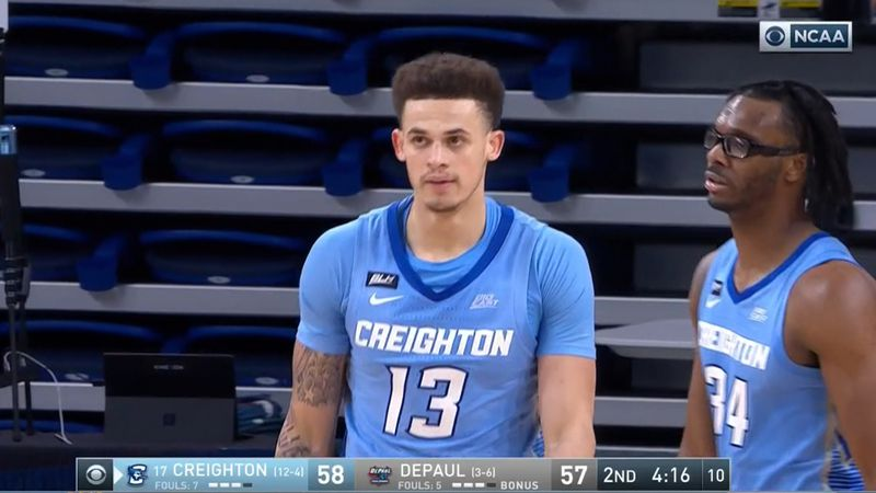 Creighton's Christian Bishop walks to the free throw line after and and-one play against DePaul...