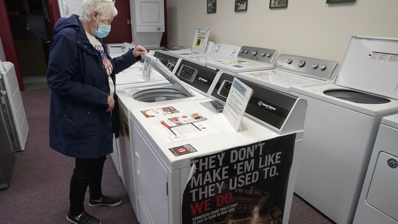 Alanna Kelly, of Norwood, Mass., examines clothes washers and dryers on display at Sam's...