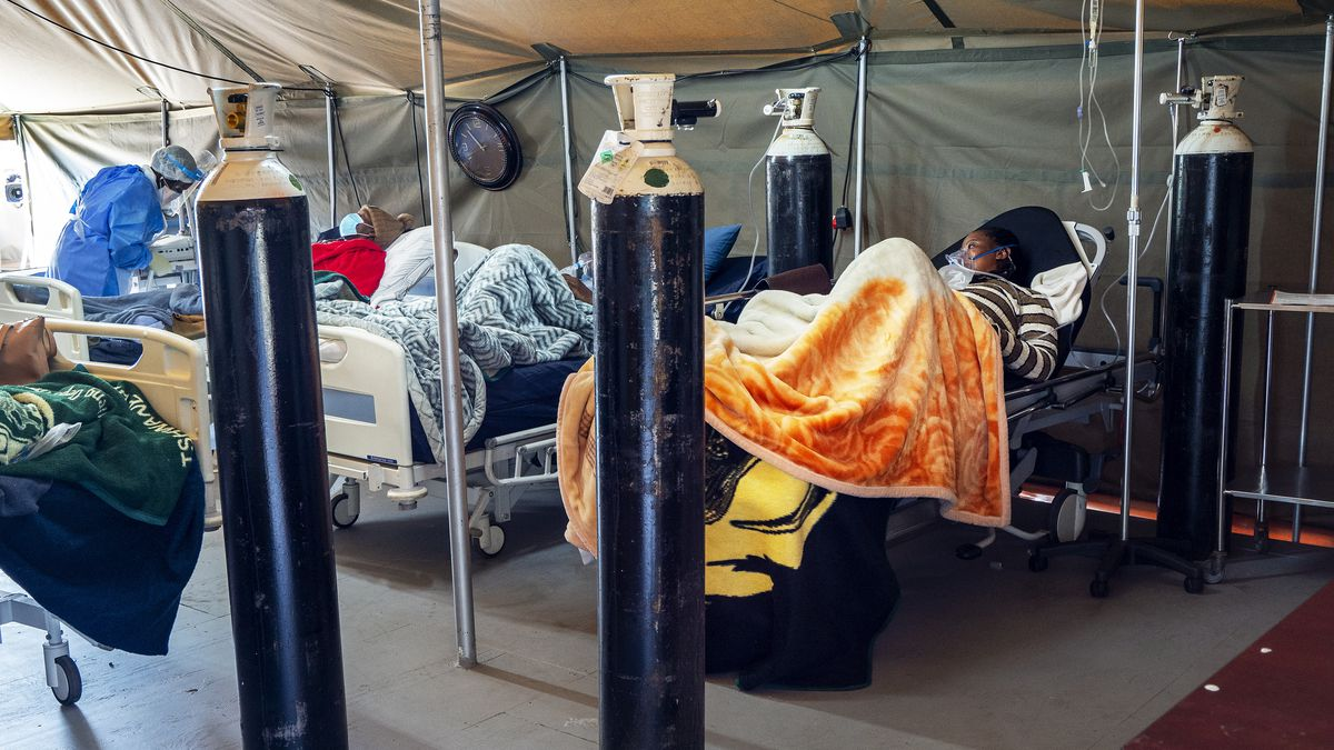 FILE - This July 10, 2020 file photo shows Covid-19 patients being treated with oxygen at the...