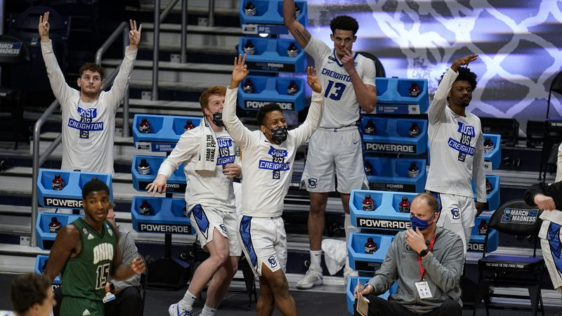 The Creighton bench celebrates in the second half of a second-round game against Ohio in the...