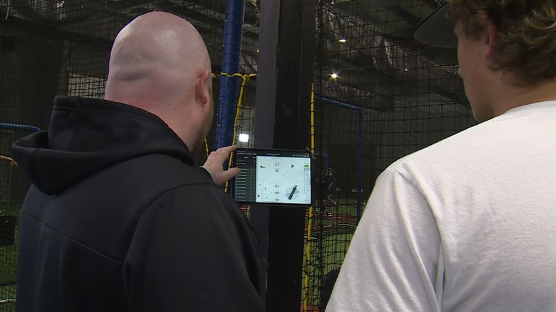 Brian Southworth analyzes pitches with Creighton Prep freshman Michael Meckna at Wired Training...
