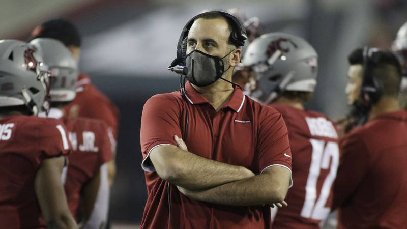 Washington State head coach Nick Rolovich looks on during the first half of an NCAA college...