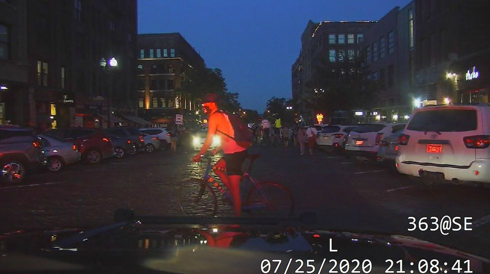 Omaha Police photo shows a bicyclist in the street in the Old Market. OPD said Wednesday, July 29, 2020, that they deployed pepperballs after the bicyclist ignored their verbal commands and rode his bike at officers in the hours following a protest on Saturday, July 25, 2020.