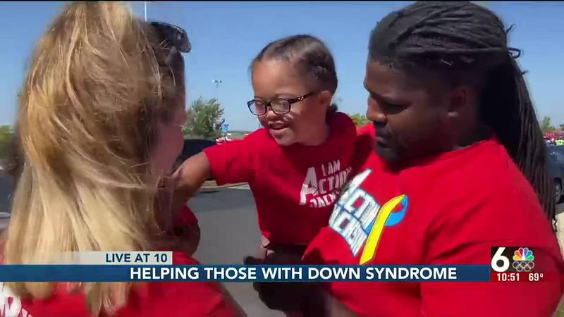 Over 2,000 people participated in Papillion's Step Up for Downs Syndrome walk at Werner Park...
