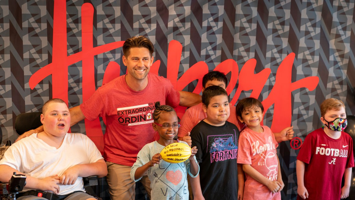 Courtesy of Aaron Babcock. Eric Crouch with Ronald McDonald House Charity children in Omaha.
