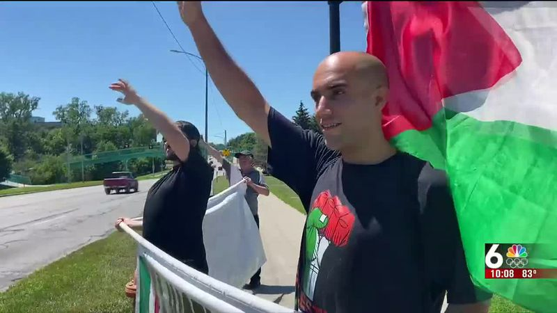 The sounds of support could be heard alongside Dodge Street Sunday afternoon as dozens gathered...