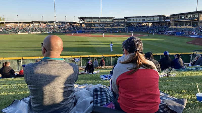 Two fans enjoy a Storm Chasers game at Werner Park