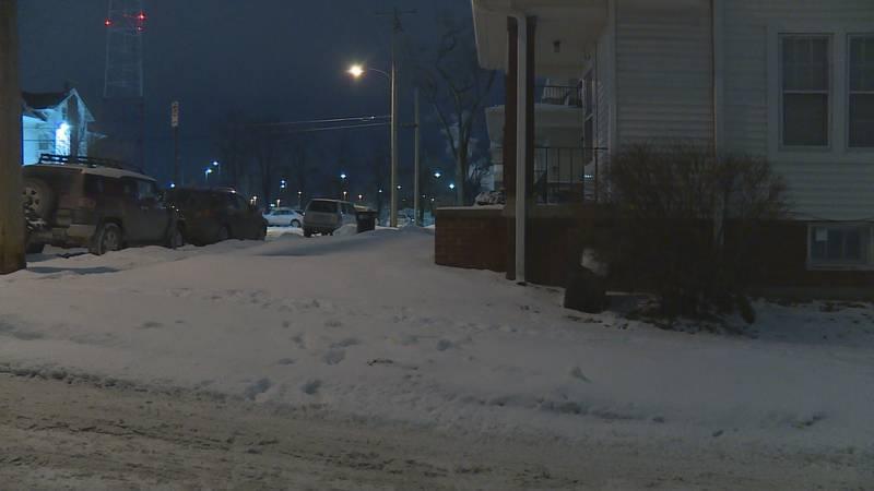 Some sidewalks were still snow-covered Tuesday night near 35th Street and Dewey Avenue.