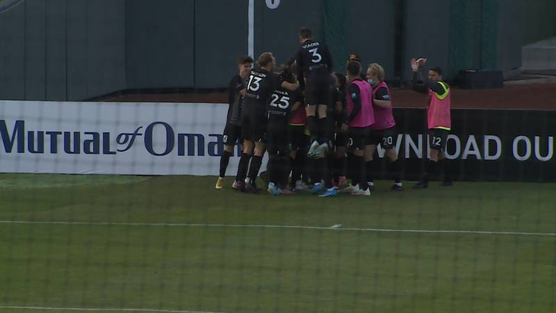 Union Omaha players celebrate after a Greg Hurst goal in the 83rd minute in a 2-0 win over...