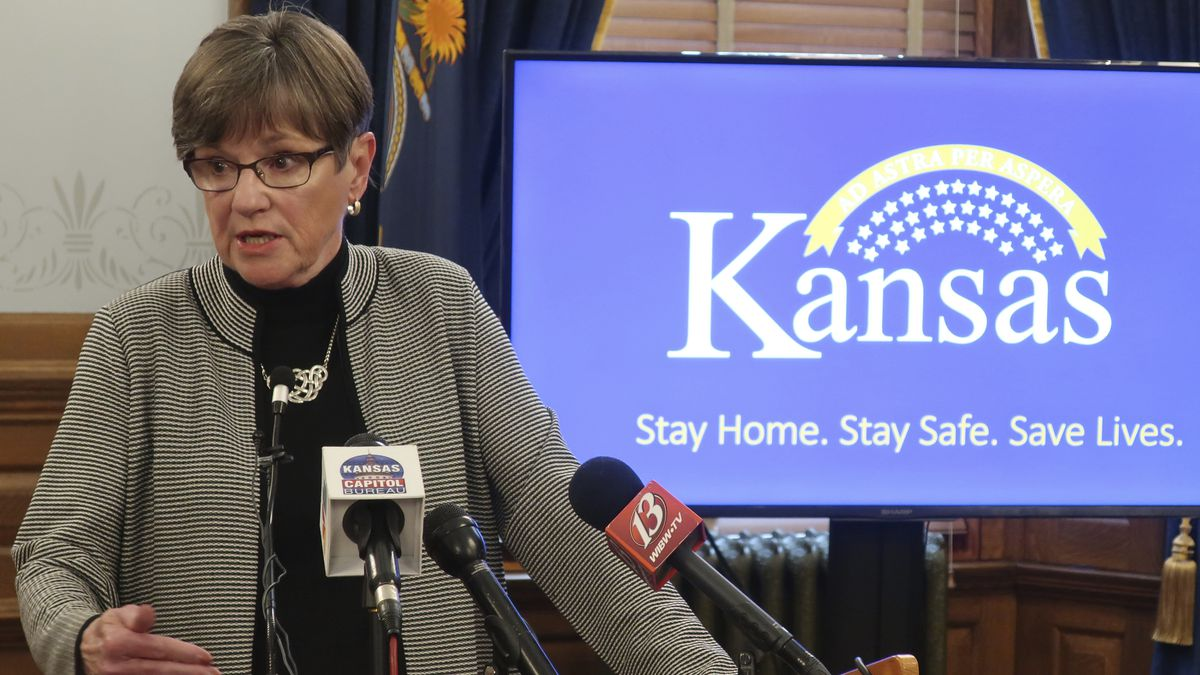 Kansas Gov. Laura Kelly answers reporters' questions during a news conference, Tuesday, May 26,...