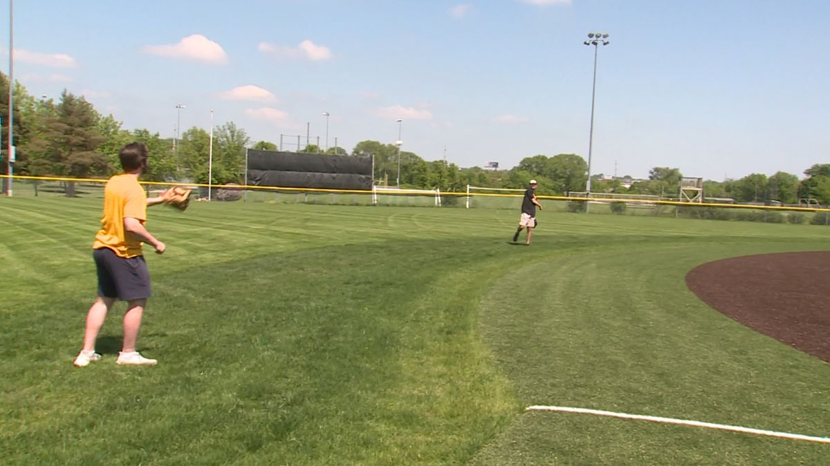 College baseball players warm up their arms at Skutt Catholic High School on Saturday, 5/23/20. (Rex Smith)