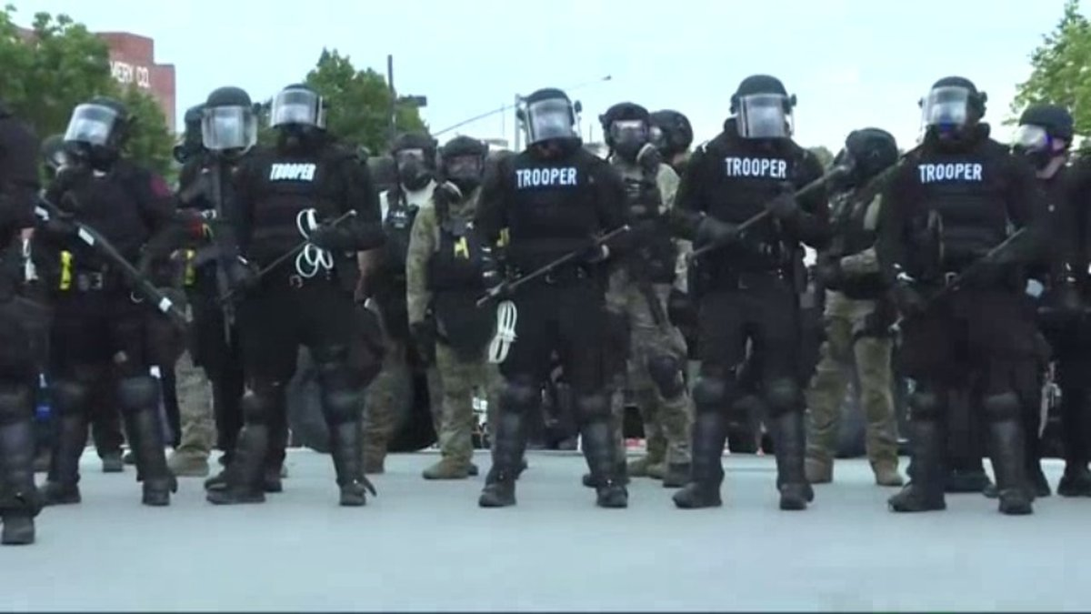 Nebraska National Guard soldiers back up Omaha Police during a protest in Omaha on June 1,...