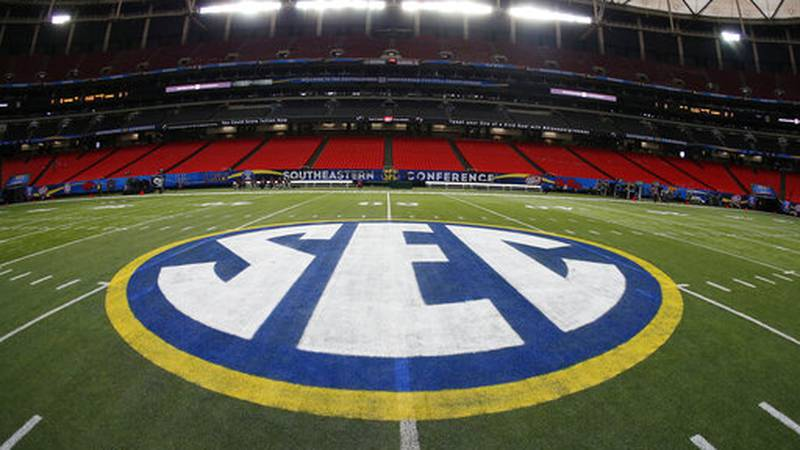 FILE - In this Dec. 5, 2014, file photo, the SEC logo is displayed on the field ahead of the...