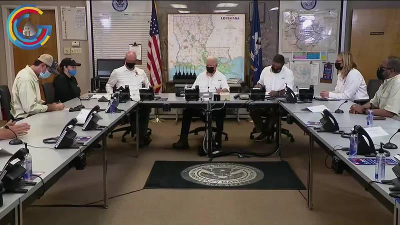President Joe Biden speaks with officials in LaPlace, Louisiana on Friday.