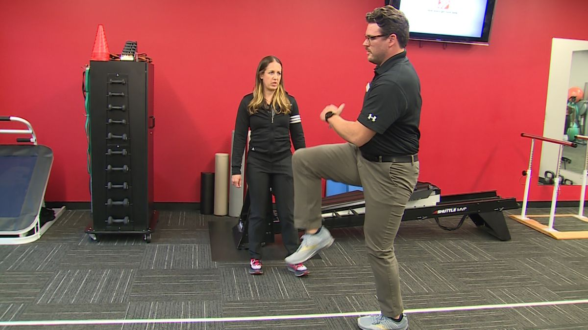 Marcus Palimenio and Lauren Watson demonstrate a dynamic warm-up at Makovicka Physical Therapy in Omaha on Friday, 5/22/20. (Rex Smith)