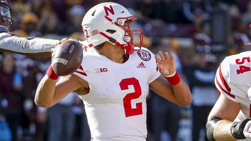 Nebraska quarterback Adrian Martinez (2) passes under pressure from Minnesota during the first...