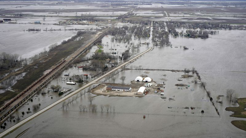 In this Friday, April 12, 2019 photo, the flooded town of Pacific Junction, Iowa, is seen from...