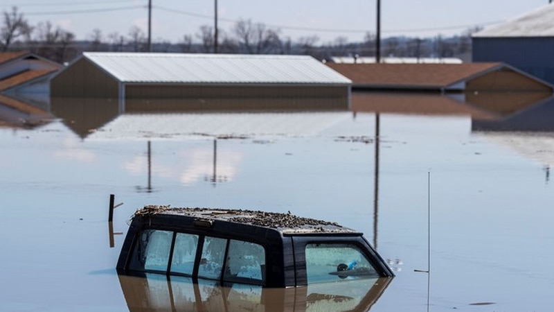 The cab of a pickup truck peeks out of floodwaters Wednesday, March 20, 2019, in Hamburg, Iowa....