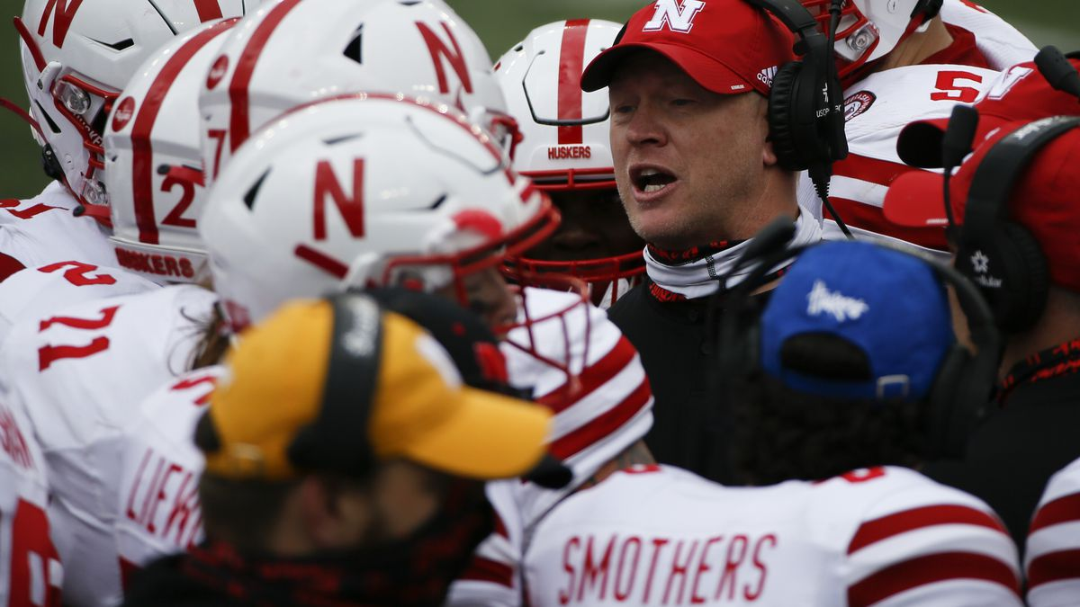 Nebraska Cornhuskers head coach Scott Frost talks to players during the second quarter of a...
