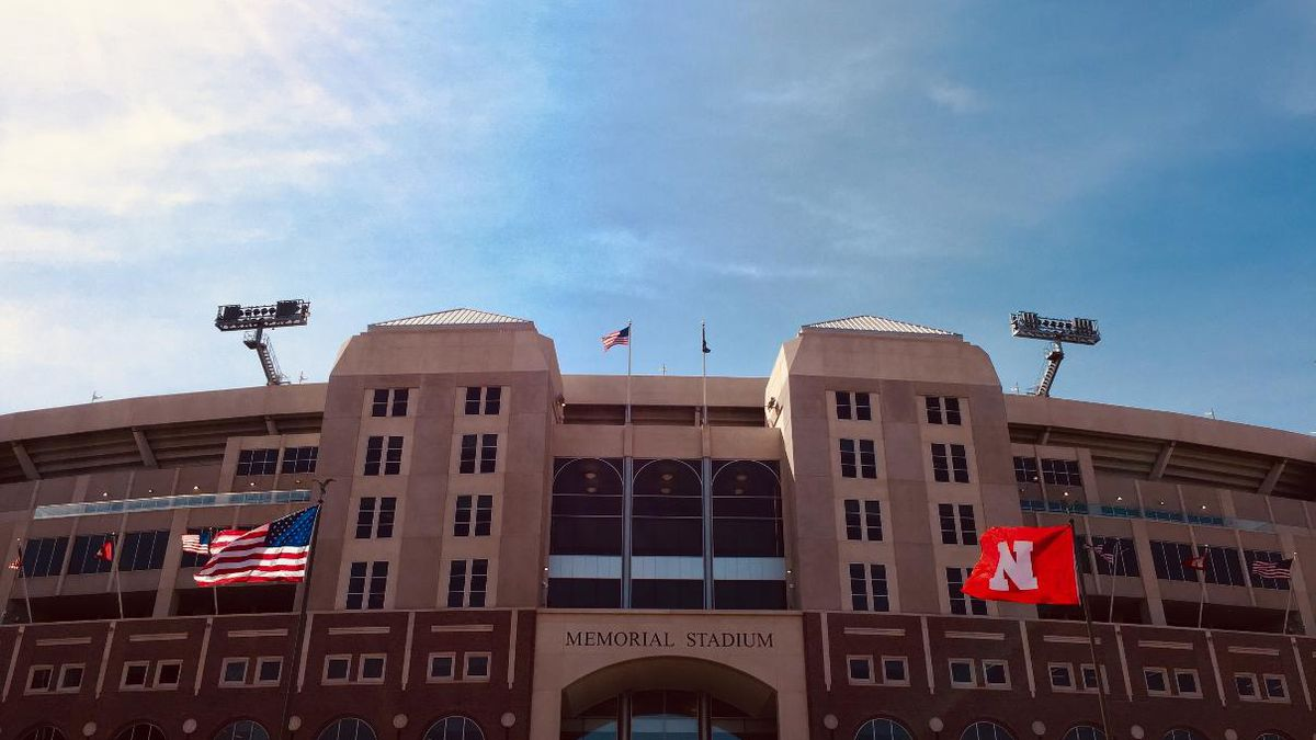 Flags fly in front of Memorial Stadium in Lincoln, Neb., after the Red-White Spring Game on Saturday, April 13, 2019.