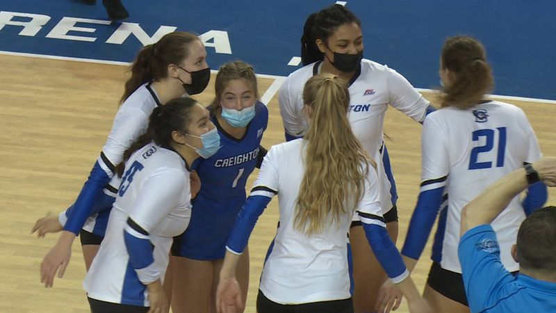 Creighton volleyball players celebrate after a kill by Kiana Schmitt against DePaul at D.J....