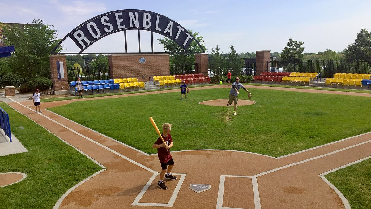 A pitch is thrown for a batter during an impromptu ball game at the Infield at the Zoo, outside Omaha's Henry Doorly Zoo & Aquarium, on Monday, June 17, 2019. The diamond commemorates the location of Rosenblatt Stadium, where the College World Series formerly took place. (Mike Plews / WOWT)