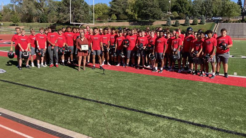 Dom Rezac is awarded Athlete of the Week in front of his Warriors teammates at Westside high...