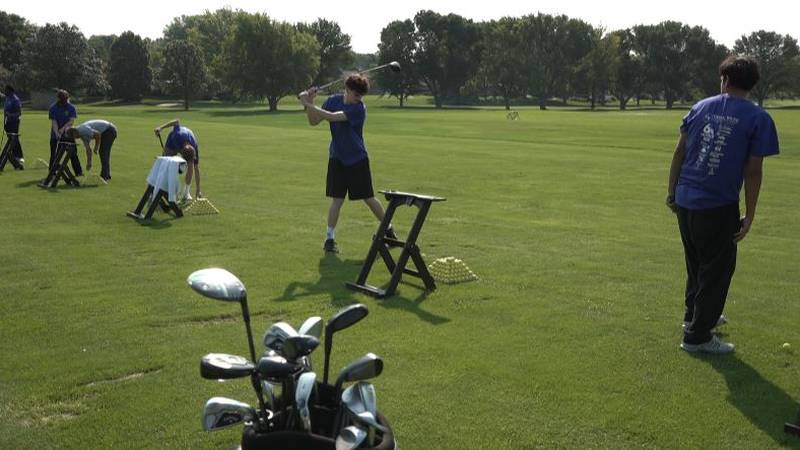 Some of the residents with the Omaha Home for Boys received free golf lessons from a real pro!