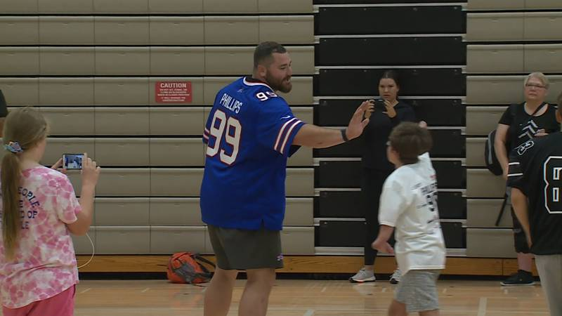 Bills defensive end Harrison Phillips high-fives with a camp attendee at his 3rd annual...