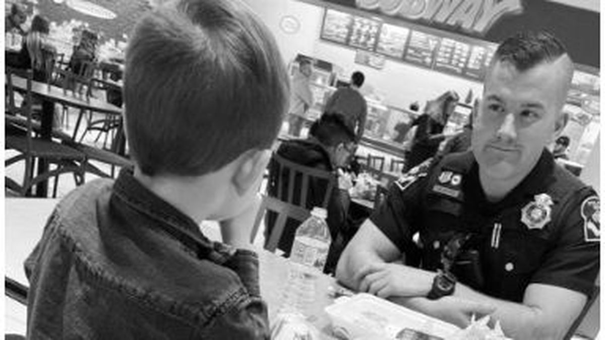When Oliver saw an Omaha Police officer eating at the Westroads food court alone, he asked to...