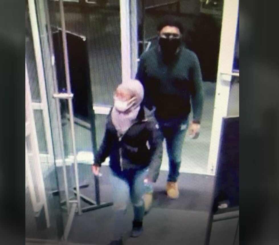 Two people were caught on camera shoplifting jackets