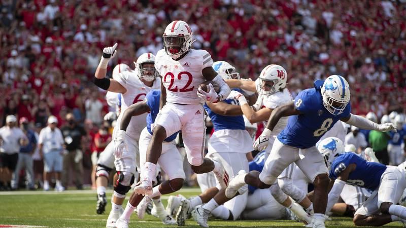 Nebraska's Gabe Ervin Jr. leaps into the end zone for a touchdown (AP Photo/Rebecca S. Gratz)