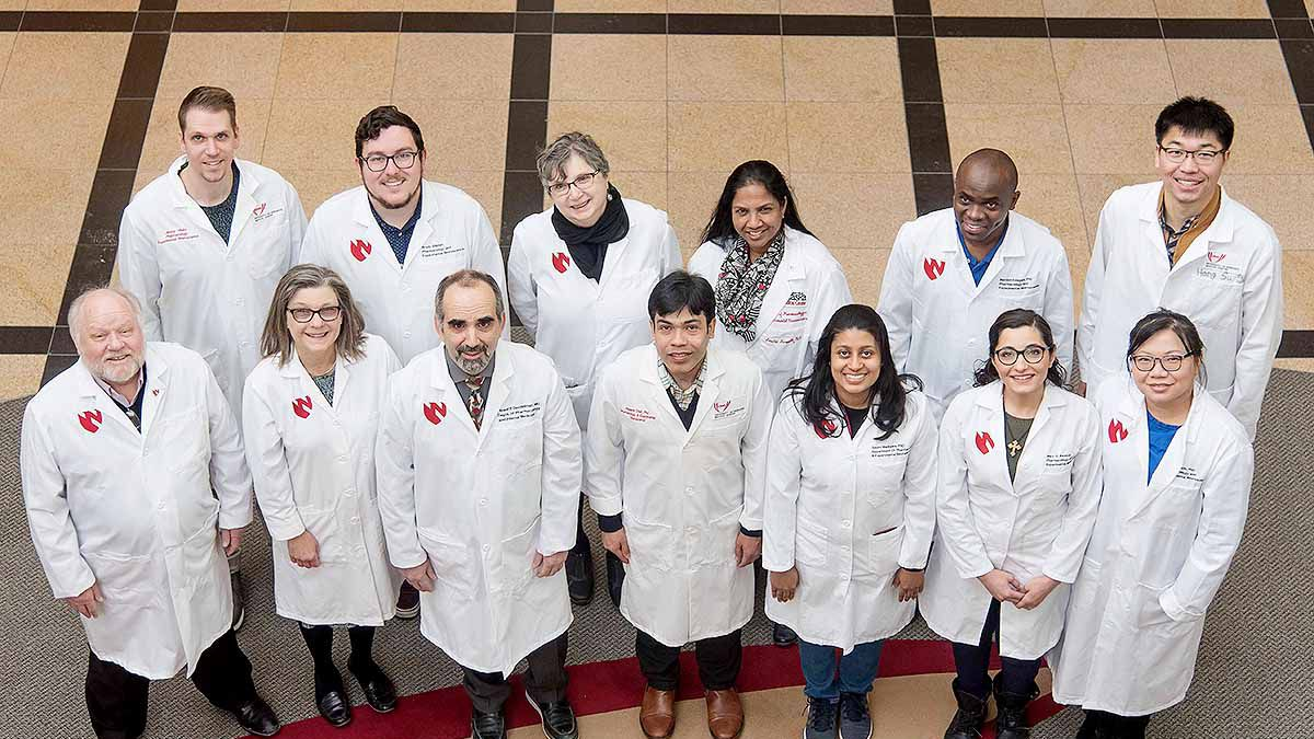 Members Dr. Howard Gendelman's group at UNMC. Back row from left: <br />James Hilaire, Brady Sillman, Ph.D.; Larisa Poluektova, M.D., Ph.D.; Santhi Gorantla, Ph.D.; Benson Edagwa, Ph.D.; and Hang Su. Front row from left: R. Lee Mosley, Ph.D.; JoEllyn McMillan, Ph.D.; Howard Gendelman, M.D.; Prasanta Dash, Ph.D.; Saumi Mathews, Ph.D.; Mary Banoub, and Zhiyi Lin. Team members not pictured: Aditya Bade, Ph.D.; and Nagsen Gautam, Ph.D. (Photo courtesy of UNMC)