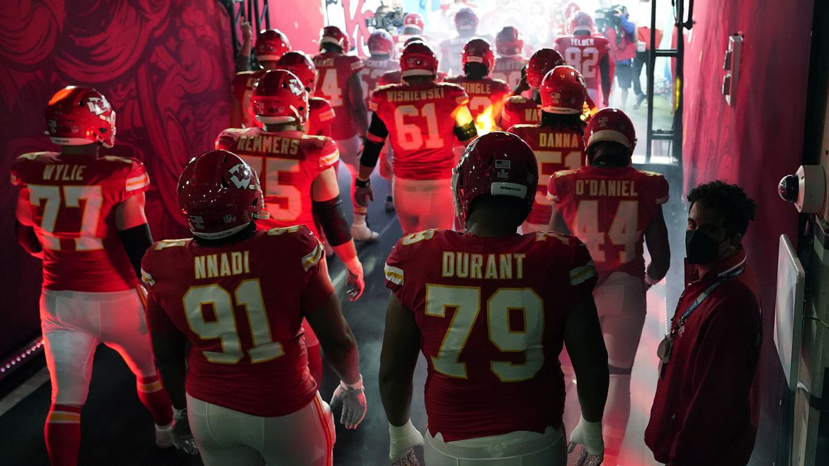 The Kansas City Chiefs run onto the field before the NFL Super Bowl 55 football game between...