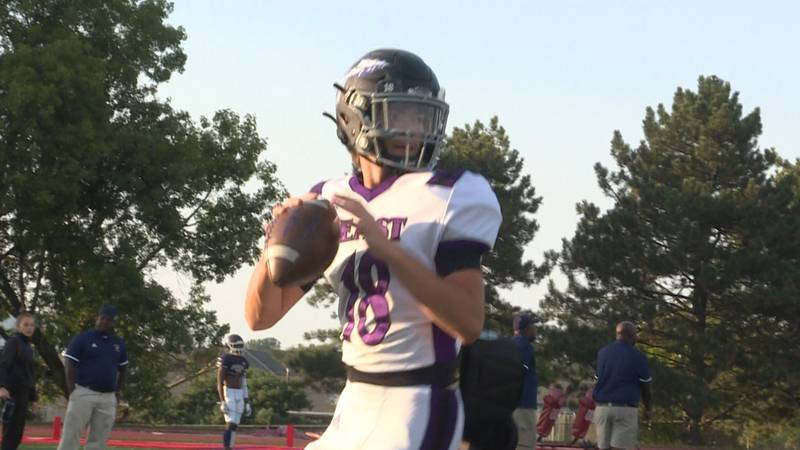 Bellevue East freshman quarterback Mikey Gow warms up prior to a game against Omaha Northwest...