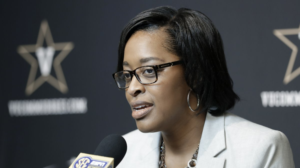 FILE - Then-Vanderbilt interim athletic director Candice Lee answers questions during a news...