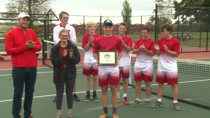 Gavin Forster is awarded Athlete of the Week on the tennis courts at Mount Michael Benedictine...