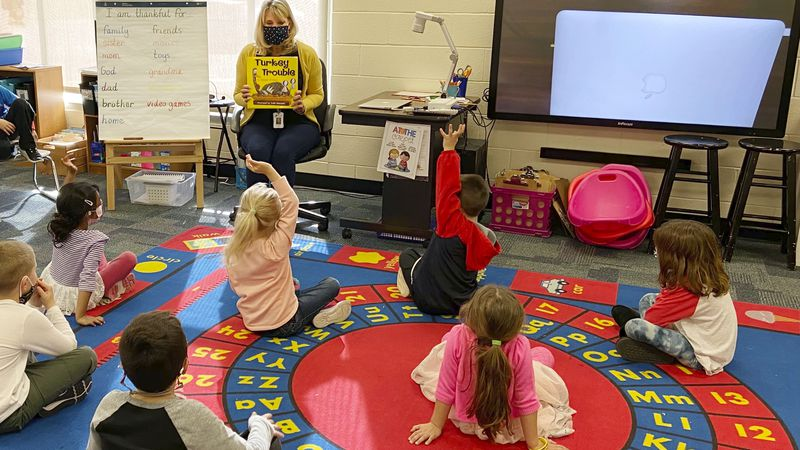 In this photo provided by Julie Mackett, the kindergarten teacher conducts her class at Ft....
