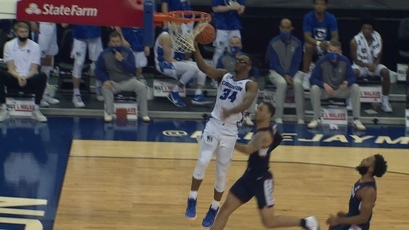 Creighton's Denzel Mahoney soars in to score two of his 20 points against the Huskies at the...