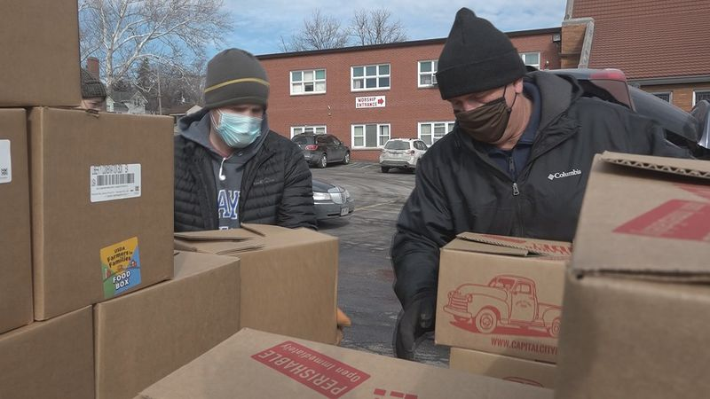 A local church partnered with a non-profit, Whispering Roots, to distribute USDA Farmer to...