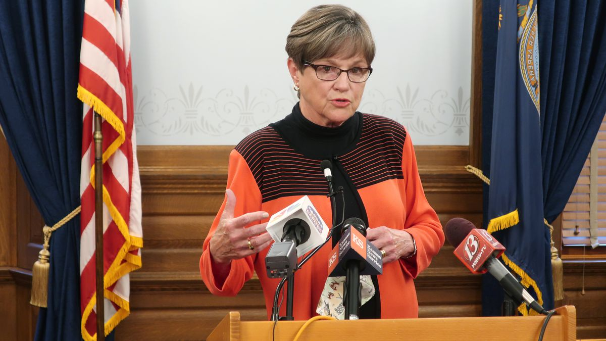 Kansas Gov. Laura Kelly discusses the coronavirus pandemic with reporters during a news...